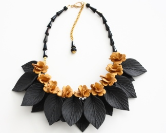 black leaves with gold flowers